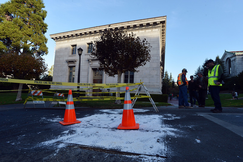 Crews assess the scene of an electrical fire at UC Berkeley in Berkeley, Calif., on Tuesday, Oct. 1, 2013. The Monday evening fire caused an extensive power outage with many buildings still closed on Tuesday. (Kristopher Skinner/Bay Area News Group)