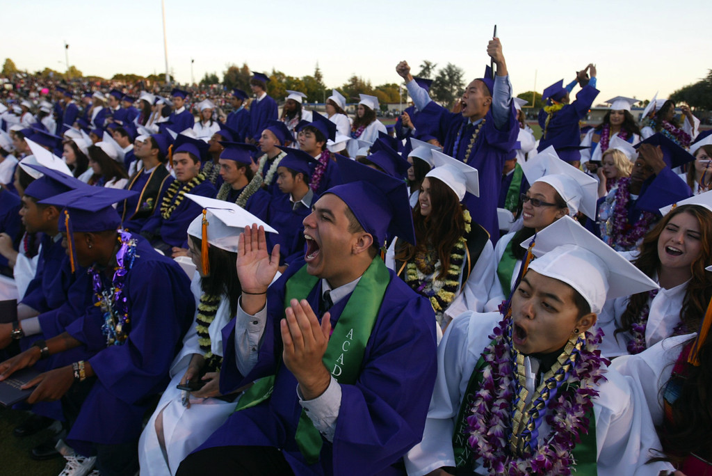. Kennedy High School graduates celebrate during their commencement ceremony in Fremont, Calif., on Wednesday, June 19, 2013. (Anda Chu/Bay Area News Group)