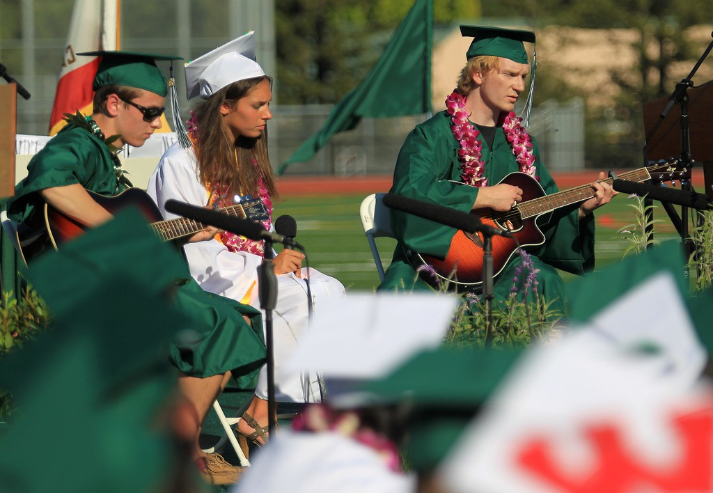 ". John Pugliese, Anna Boer and Toran Davenport, left to right, play Bob Dylan\'s ""The Times They Area A Changin\"" during the Miramonte High School\'s 54th commencement ceremony in Orinda, Calif., on Friday, June 7, 2013.  (Jane Tyska/Bay Area News Group)"