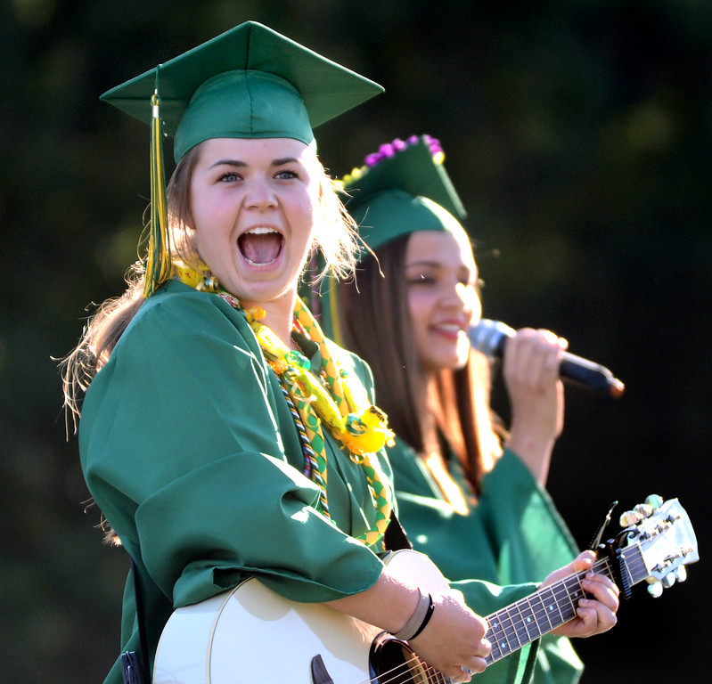 ". San Ramon Valley High School graduate Katie Lencioni, left, reacts as she and Briana Gohranson, perform the song ""Four Years Strong \"" written by Lencion during the school\'s Commencement Ceremony in Danville, Calif., on Friday, June 14, 2013. (Doug Duran/Bay Area News Group)"