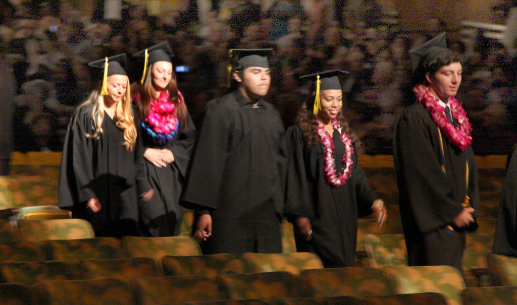 . Seniors enter the theatre for the fifty-ninth commencement ceremonies of Bishop O\'Dowd High School at the Paramount Theatre of the Arts in Oakland, Calif. on Sunday, June 2, 2013. (Jim Stevens/Bay Area News Group)