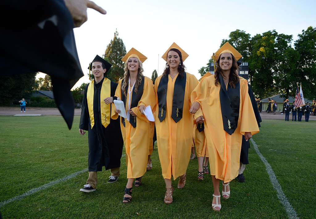 . A teacher signals to students as they walk onto the field during graduation ceremonies at Antioch High School in Antioch, Calif., on Thursday, June 6, 2013. (Jose Carlos Fajardo/Bay Area News Group)