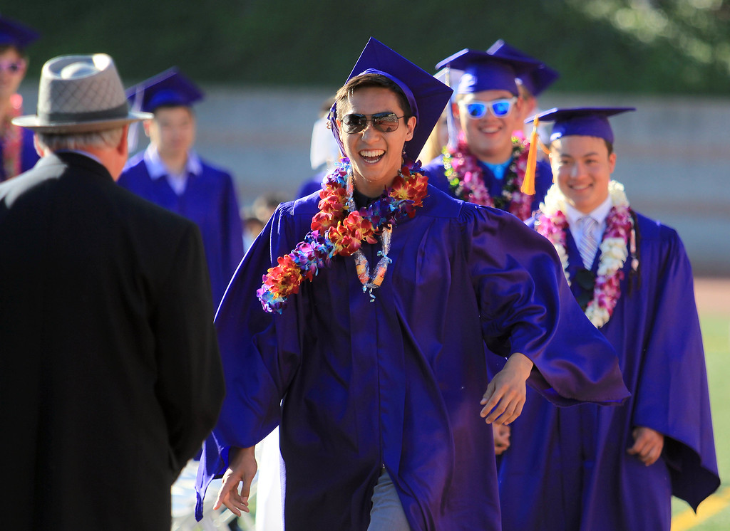 . Jonathan Tran receives his diploma from principal Rich Kitchens, left, during commencement ceremonies at Piedmont High School in Piedmont, Calif., on Thursday, June 13, 2013.  (Jane Tyska/Bay Area News Group)
