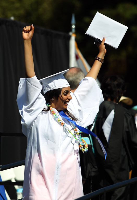 . Simran Bajwa, 18, Irvington High School graduates celebrates after receiving her diploma during their commencement ceremony in Fremont, Calif., on Thursday, June 20, 2013. (Anda Chu/Bay Area News Group)