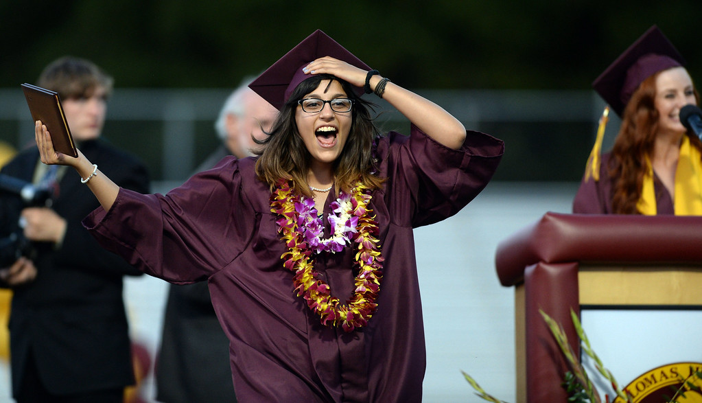 . Sara Zavala is all smiles after receiving her diploma at the 2013 Las Lomas High School Commencement held on the Las Lomas High School campus in Walnut Creek, Calif. on Friday, June 7, 2013. (Dan Honda/Bay Area News Group)