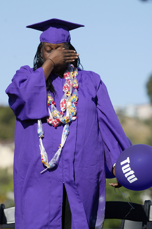 . Wolanda Christopher, mother of deceased senior Olajuwon Clayborn, cries during a tribute in his honor during the Castlemont High School graduation ceremony of the Class of 2013  at the school\'s football field in Oakland, Calif., on Friday, June 14, 2013.  Christopher received Clayborn\'s diploma who was fatally killed in East Oakland on May 5, 2013.  (Ray Chavez / Bay Area News Group)