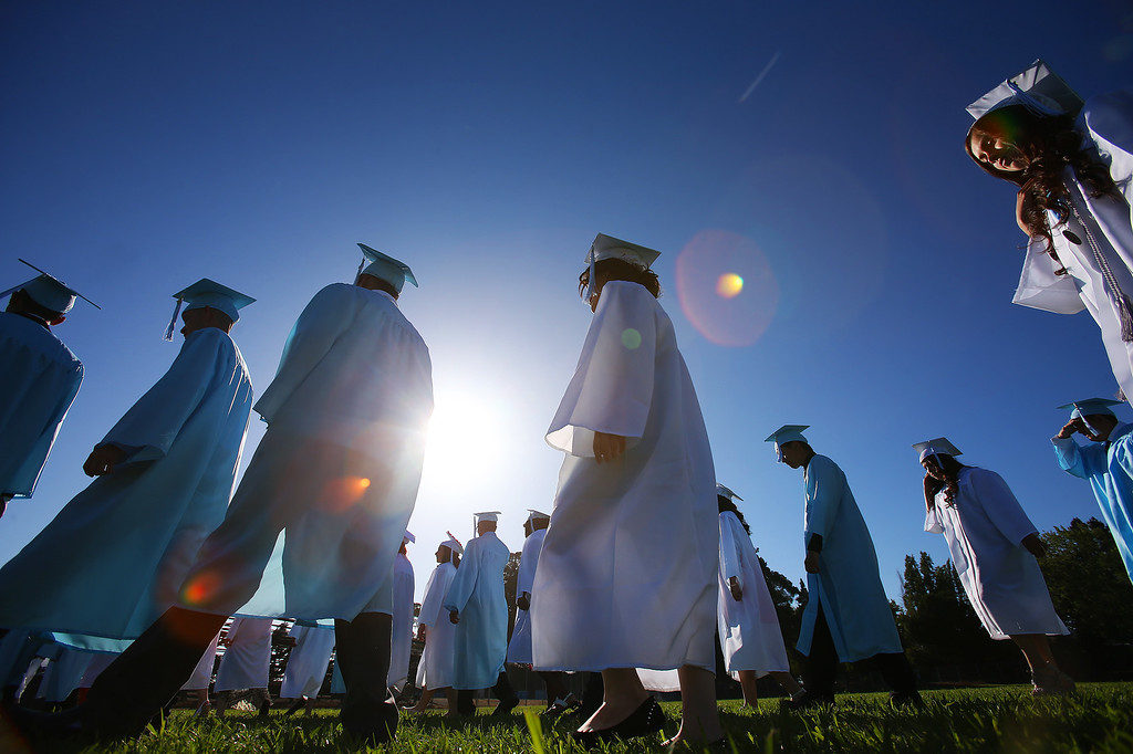 . Tennyson High School graduates make their way to the school\'s football field during commencement ceremonies on Thursday, June 13, 2013 in Hayward, Calif.  (Aric Crabb/Bay Area News Group)