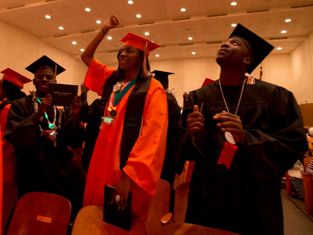 . Graduates cheer their official graduation proclamation during the commencement exercises for the Class of 2013 at McClymonds High School, Thursday, June 13, 2013 in Oakland, Calif. (D. Ross Cameron/Bay Area News Group)
