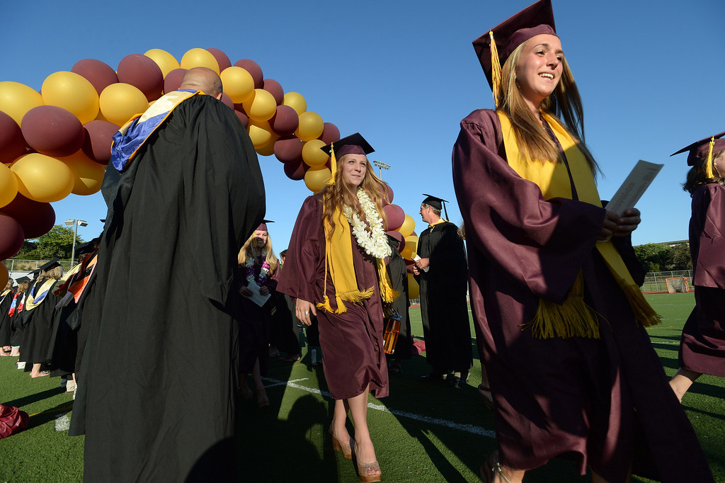 . Graduates march to their seats through a balloon arch at the 2013 Las Lomas High School Commencement held on the Las Lomas High School campus in Walnut Creek, Calif. on Friday, June 7, 2013. (Dan Honda/Bay Area News Group)