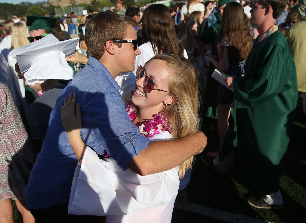 . Graduate Maddy Nicolaisen, right is congratulated by sophomore Jack Kovalik during the Miramonte High School\'s 54th commencement ceremony  in Orinda, Calif., on Friday, June 7, 2013.  (Jane Tyska/Bay Area News Group)