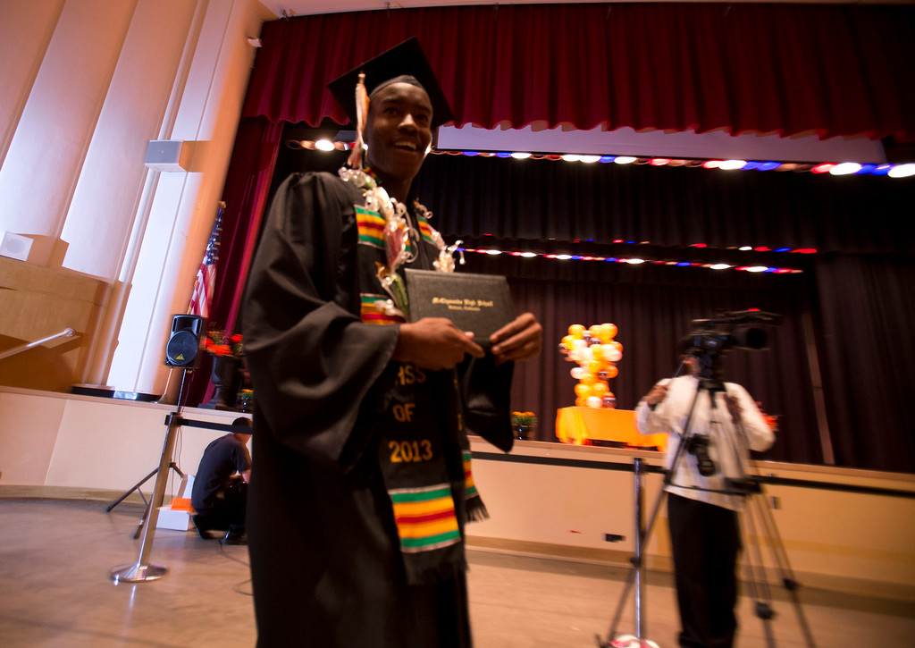 . Tahjee Williams shows off his diploma during the graduation ceremonies for the Class of 2013 at McClymonds High School, Thursday, June 13, 2013 in Oakland, Calif. (D. Ross Cameron/Bay Area News Group)