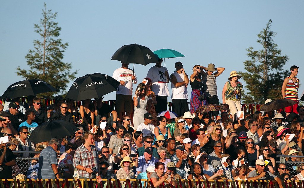 . Family and friends watch as Liberty High School Class of 2013 graduates participate in their commencement ceremony on the school\'s Ohmstede Field in Brentwood, Calif., on Friday, June 7, 2013. (Anda Chu/Bay Area News Group)