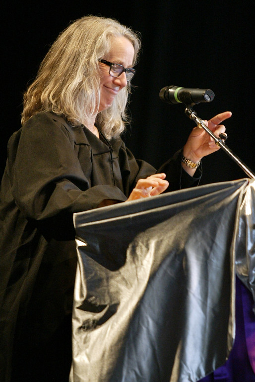 . Teacher Maragret O\'Connor addresses to the Class of 2013 during the College Park High School graduation ceremony at the Sleep Train Pavilion in Concord, Calif., on Tuesday, June 12, 2013.  (Ray Chavez/Bay Area News Group)