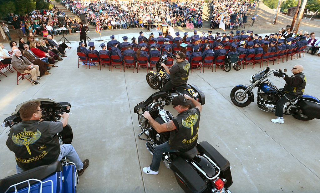 . The Saints Motorcycle Club ride into the Vicente-Martinez High School and Briones School commencement ceremony to give selected graduates scholarships in Martinez, Calif., on Wednesday, June 5, 2013. The Martinez based  motorcycle club gives scholarships to selected graduates annually. The graduation also featured class speeches by graduates Maalec Thomas and Serenity McGill, a performance by graduate Nicholas Napolitano and scholarship presentations by Martinez organizations. (Doug Duran/Bay Area News Group)