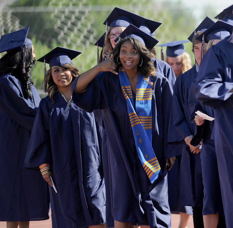 . Dominique Austin gestures to someone in the crowd to call her at the Freedom High School graduation ceremony held at Falcon Stadium on the campus of Freedom High School in Oakley, Calif., on Saturday, June 8, 2013. (Dan Honda/Bay Area News Group)