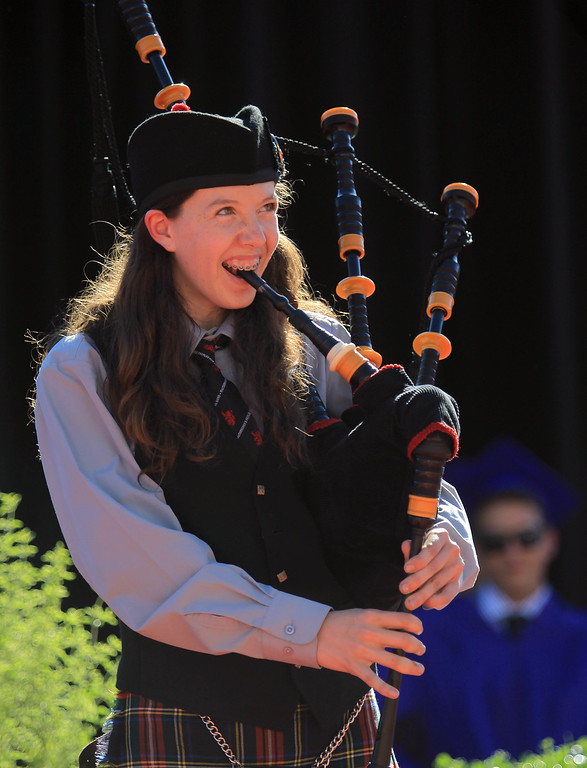 ". Freshman Alexandra Shoptaugh plays ""Scotland the Brave\"" on the bagpipes during commencement ceremonies at Piedmont High School in Piedmont, Calif., on Thursday, June 13, 2013.  (Jane Tyska/Bay Area News Group)"