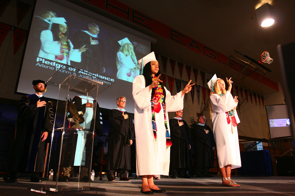 . Class of 2013 graduates Arlene Bohm and Joella Hazelett, from left, recite the Pledge of Allegiance in American Sign Language during California School for the Deaf\'s graduation ceremony in Fremont, Calif., on Friday, June 7, 2013. Forty seniors make up the school\'s 141st CSD graduating class. (Anda Chu/Bay Area News Group)