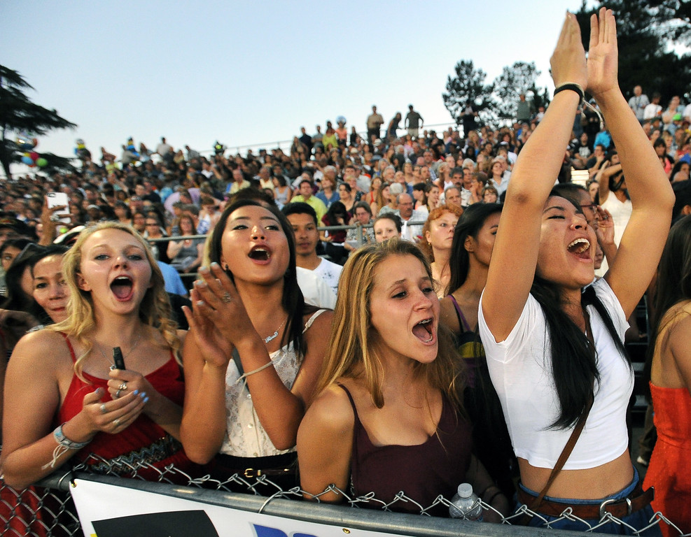 . Alhambra High School juniors, from left, Tara Schueller, Rose Clyne, Helene Hollidge, and Madison Muraoka  cheer for Alhambra High School graduates during the commencement ceremony in Martinez, Calif., on Friday, June 7, 2013. The graduation also featured a song by graduates Halia Roth, Ericka March, Connor Francis, and Harrison Flynn. Class president Christain Bumala and Salutatorian Thomas Schwemberger also gave speeches. (Doug Duran/Bay Area News Group)