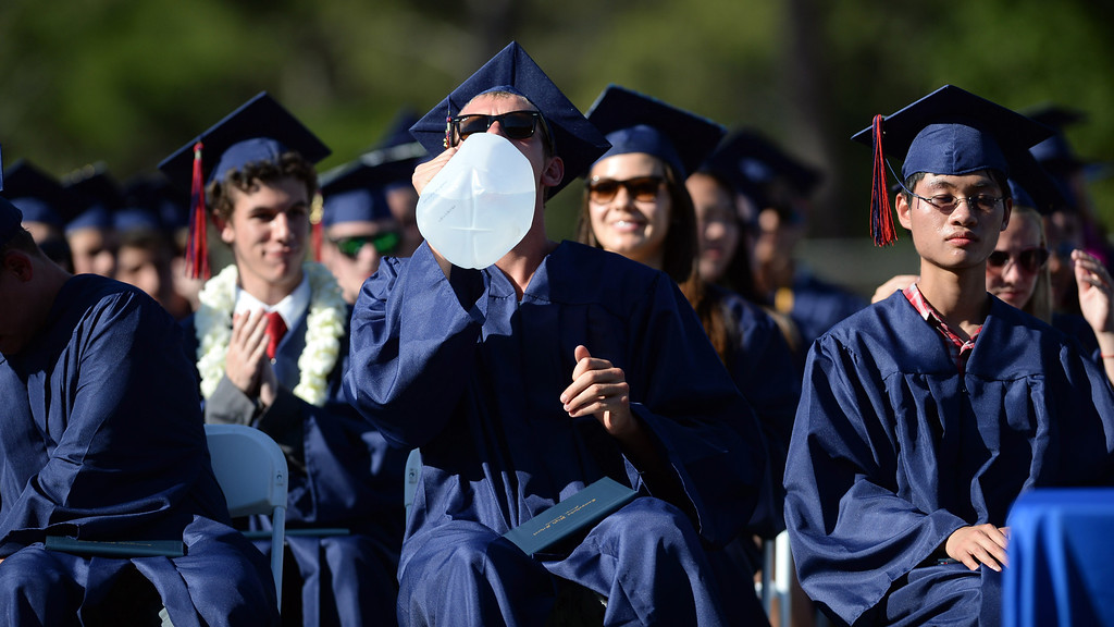 . On a very hot day, graduates tried to stay cool and hydrated at the 2013 Campolindo High School Commencement held on the Moraga, Calif., campus on Friday, June 7, 2013. (Dan Honda/Bay Area News Group)
