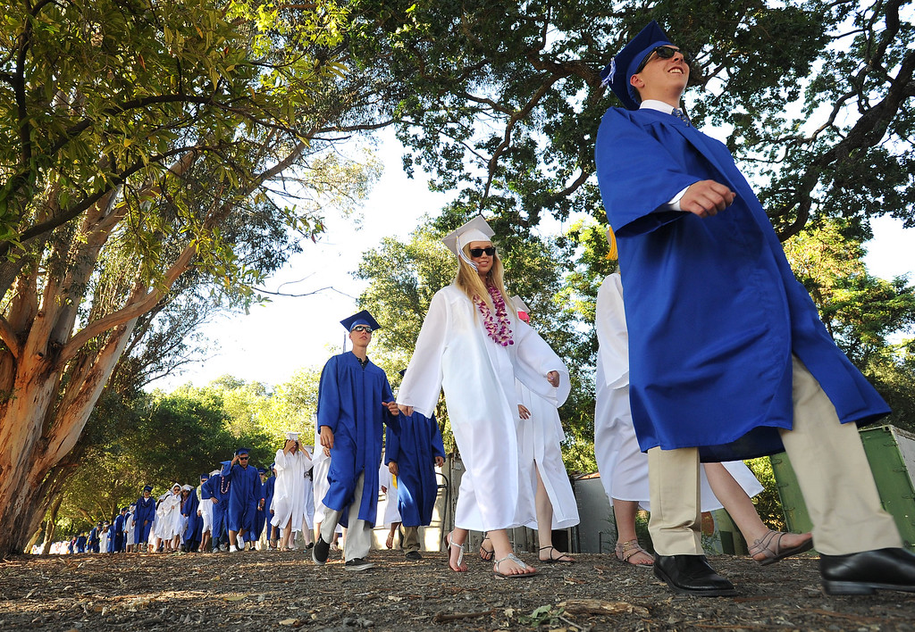. Acalanes High School graduates walk to their commencement ceremony in Lafayette, Calif., on Friday, June 7, 2013. The graduation featured speeches from graduates Edward Huddart and Carolyn Moore. (Doug Duran/Bay Area News Group)