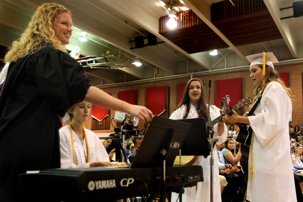 ". Carondelet High School Choral Director Amy Way, left, directs graduates Turner Wiley, piano, Kristina Waters and Emily Bjerke as they sing ""Unwritten\"" by Natasha Bedingfield during the commencement ceremony of the Class of 2013 at Carondelet High School in Concord, Calif., on Sunday, May 19, 2013. (Ray Chavez/Bay Area News Group)"