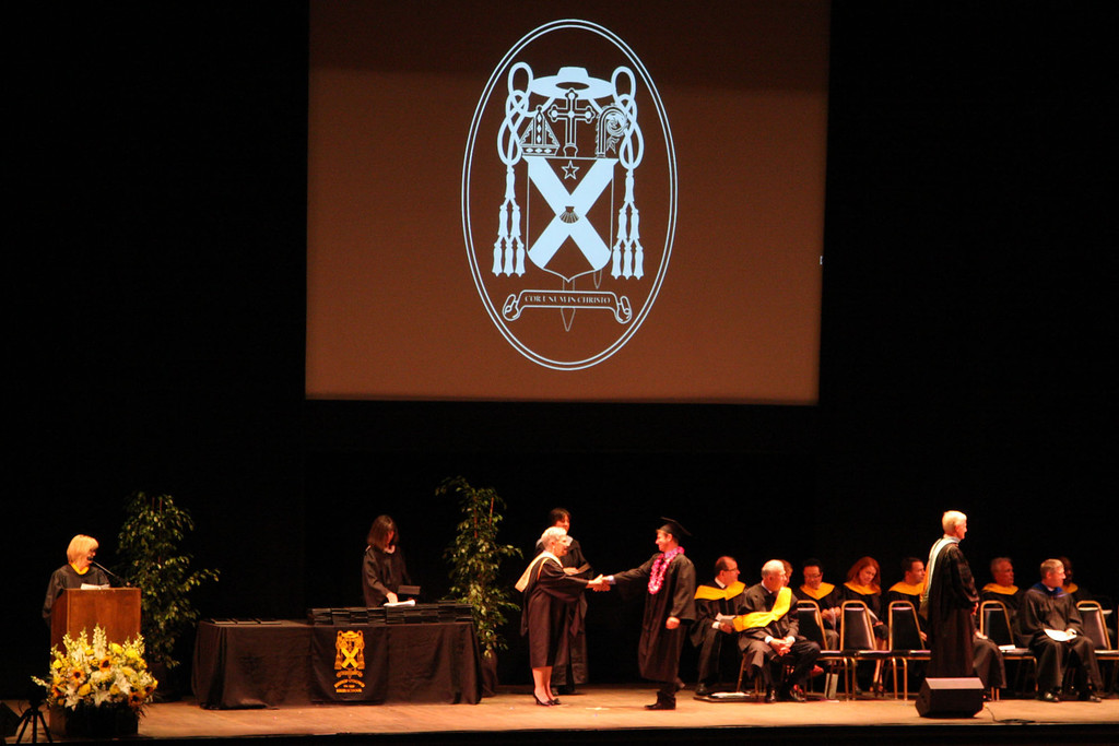 . Principal Pam Shay, presents diplomas to graduates at the fifty-ninth commencement ceremonies of Bishop O\'Dowd High School at the Paramount Theatre of the Arts in Oakland, Calif. on Sunday, June 2, 2013. (Jim Stevens/Bay Area News Group)
