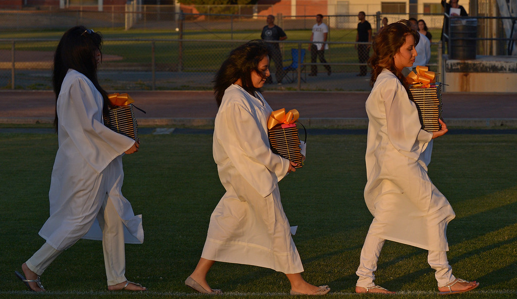 . Antioch High School junior class members carry diploma covers during graduation ceremonies at Antioch High School in Antioch, Calif., on Thursday, June 6, 2013. (Jose Carlos Fajardo/Bay Area News Group)
