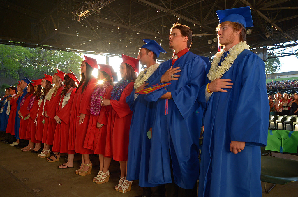 . Clayton Valley Charter High School students Jesse Medrano, from left, 18, and Eddie Juarez, 17, place their hands over their hearts as they play the national anthem during commencement ceremonies on Thursday, May 30, 2013 at Sleep Train Pavilion in Concord, Calif. (Jose Carlos Fajardo/Bay Area News Group)