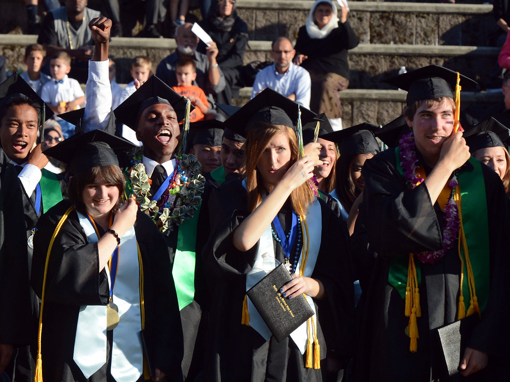 . Members of the class of 2013 prepare to move their tassels during the Dozier-Libbey Medical High School 2013 Commencement Ceremony held at Deer Valley High School in Antioch, Calif., on Wednesday, June 5, 2013. (Susan Tripp Pollard/Bay Area News Group)