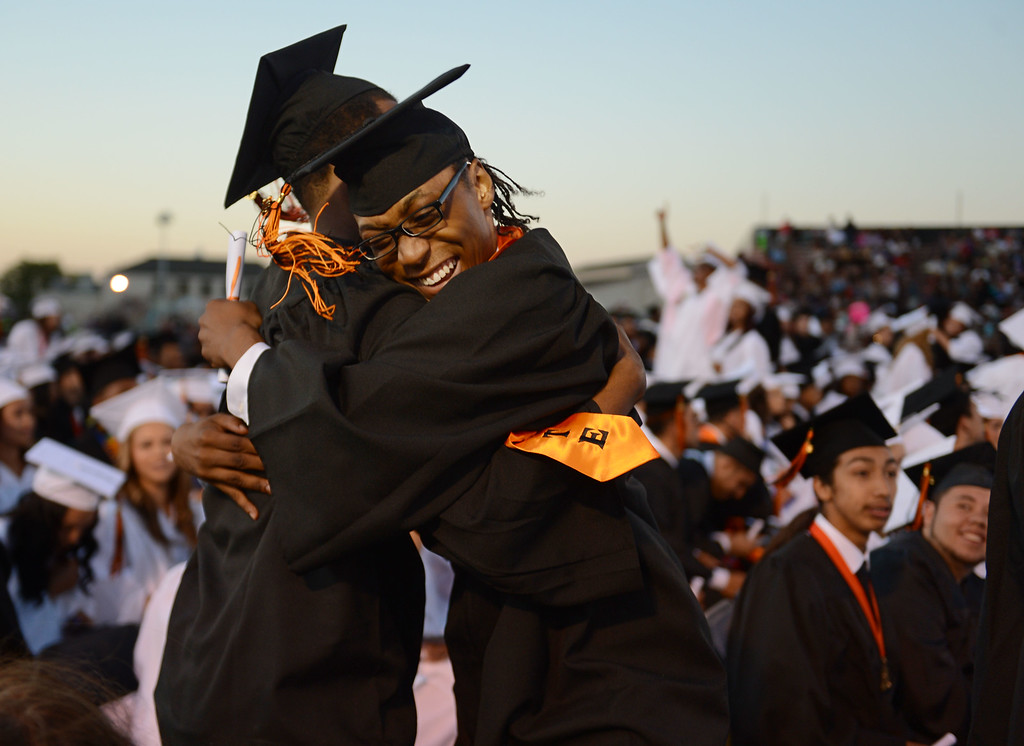 . On his birthday, Malik Terron-D Angelo Lawson, 18, right, gets a hug from his friend and classmate Norrel Lee Cooper during the 2013 commencement ceremony at Pittsburg High School in Pittsburg, Calif., Wednesday,  June 12, 2013. (Susan Tripp Pollard/Bay Area News Group)
