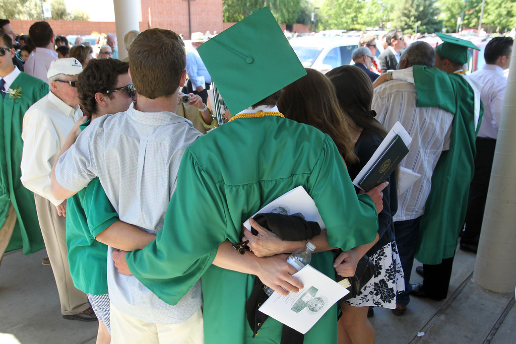 . A De La Salle graduate of the Class of 2013 has his picture taken with family members and friends following his commencement ceremony at De La Salle High School in Concord, Calif., on Sunday, May 19, 2013. (Ray Chavez/Bay Area News Group)