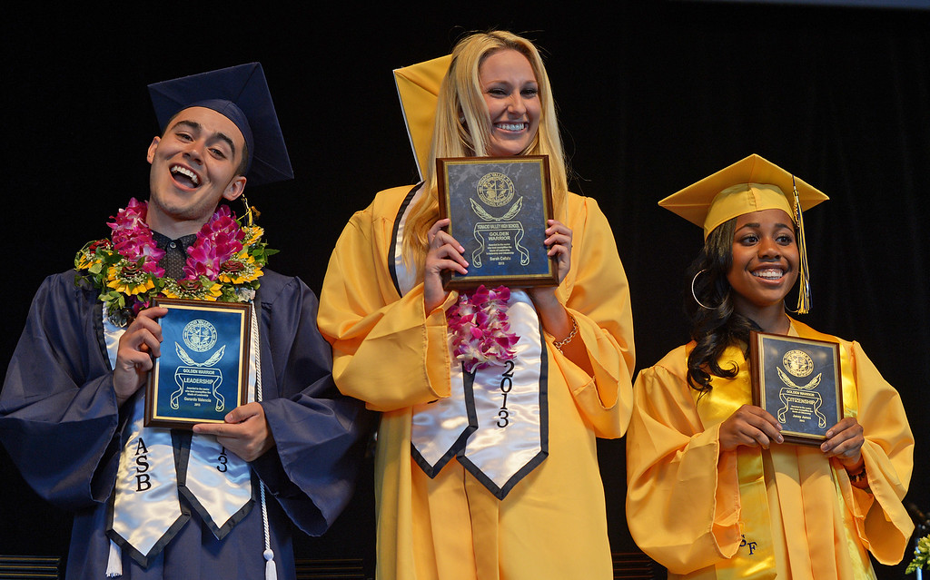 . Ygnacio Valley High School students Gerardo Valencia, from left, Sarah Cefalu and Janay James hold their 2013 Golden Warriors Leadership awards during commencement ceremonies at Sleep Train Pavilion in Concord, Calif., on Thursday, June 13, 2013. (Jose Carlos Fajardo/Bay Area News Group)