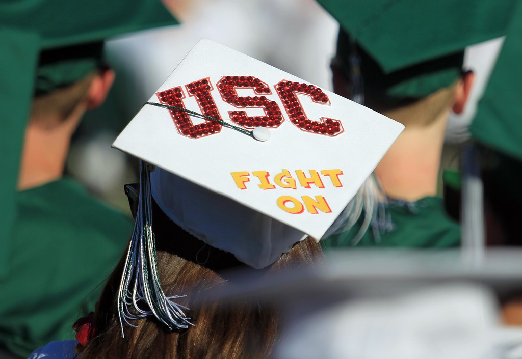 . A graduate wears a University of Southern California logo on her cap during Miramonte High School\'s 54th commencement ceremony in Orinda, Calif., on Friday, June 7, 2013. (Jane Tyska/Bay Area News Group)