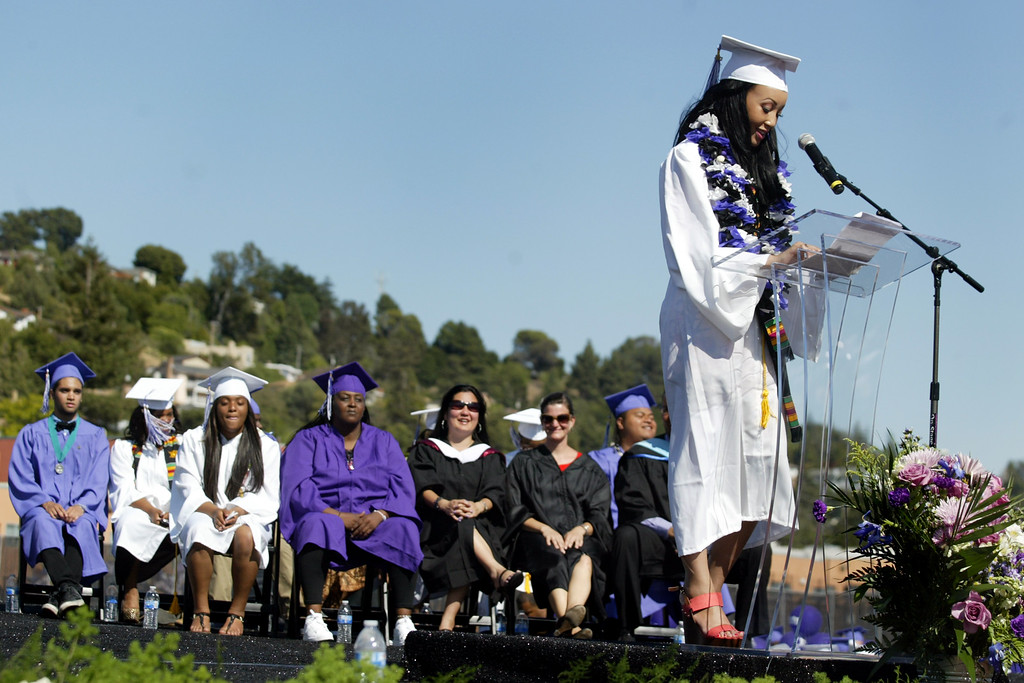 . Valedictorian Zelana Smith addresses her speech to the Class of 2013 during the Castlemont High School graduation ceremony in Oakland, Calif., on Friday, June 14, 2013. (Ray Chavez /Bay Area News Group)