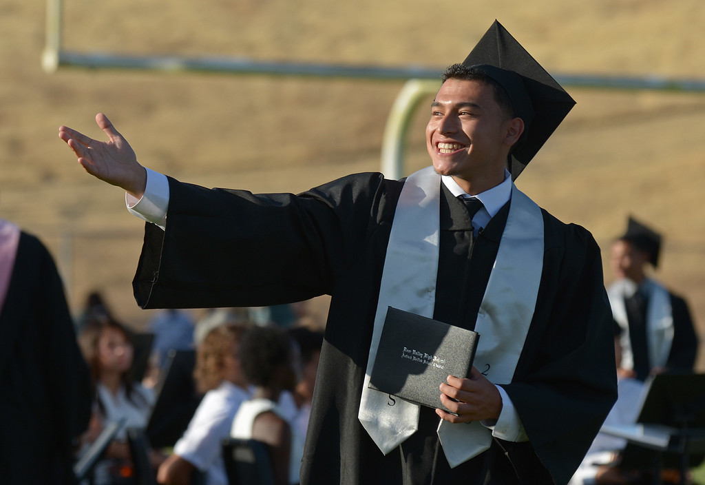 . Student Giankarlo Alvarado, 17, blows a kiss to his family in the stands during graduation ceremonies at Deer Valley High School in Antioch, Calif., on Thursday, June 6, 2013. (Jose Carlos Fajardo/Bay Area News Group)