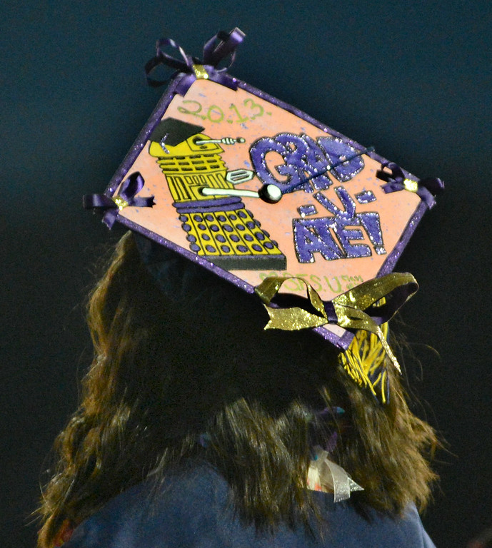 . Alhambra High School graduate Halia Roth gets her diploma wearing her mortarboard decorated with a Dalek from the show Doctor Who during their commencement ceremony in Martinez, Calif., on Friday, June 7, 2013. The graduation also featured a song by graduates Halia Roth, Ericka March, Connor Francis, and Harrison Flynn. Class president Christain Bumala and Salutatorian Thomas Schwemberger also gave speeches. (Doug Duran/Bay Area News Group)