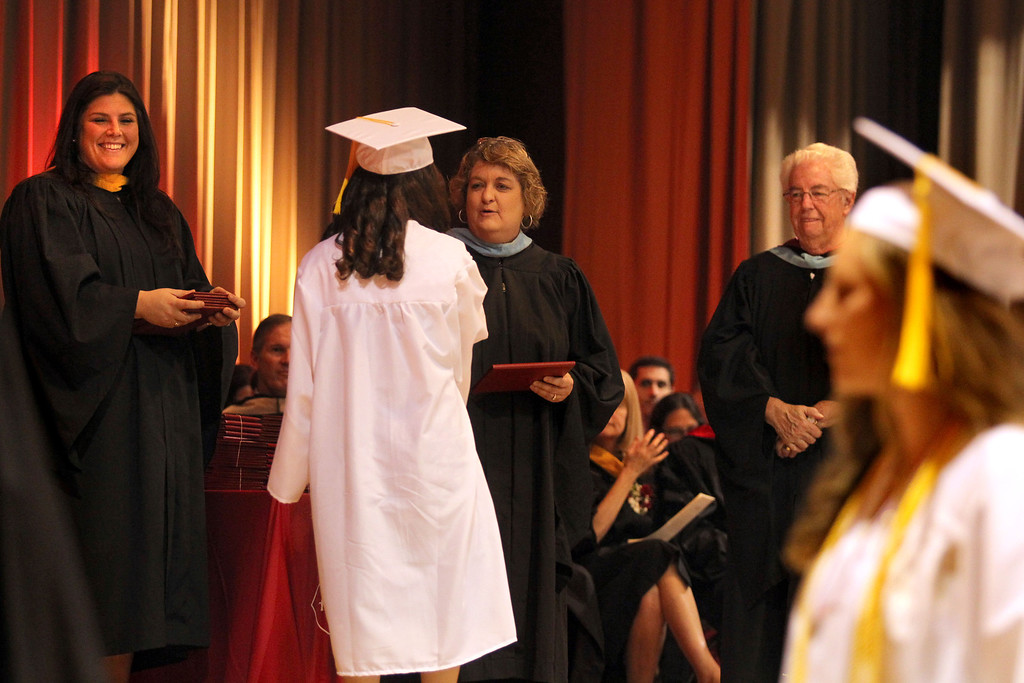 . Carondelet High School assistant Principal Jessica Mix, left,  Principal Nancy Libby and President Ann Bernard O\'Shea deliver diplomas to graduates of the Class of 2013 during the commencement ceremony at Carondelet High School in Concord, Calif., on Sunday, May 19, 2013. (Ray Chavez/Bay Area News Group)