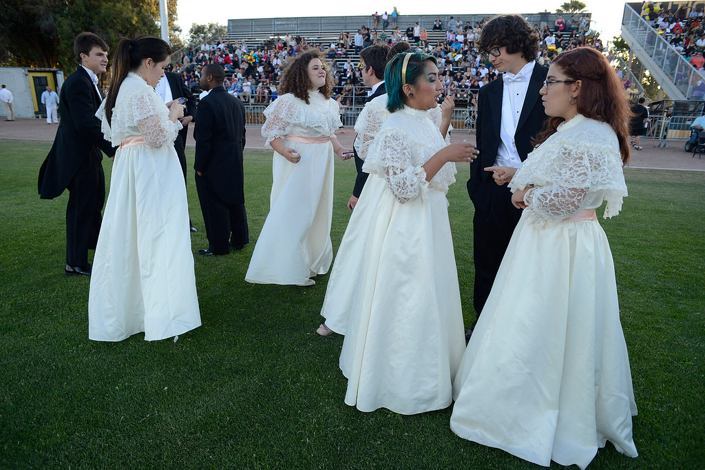 . Members of the Music Masters of Antioch High School hang around waiting for the start of graduation ceremonies at Antioch High School in Antioch, Calif., on Thursday, June 6, 2013. (Jose Carlos Fajardo/Bay Area News Group)