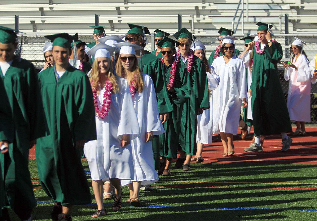 . The class of 2013 enters the football field during  Miramonte High School\'s 54th commencement ceremony  in Orinda, Calif., on Friday, June 7, 2013.  (Jane Tyska/Bay Area News Group)