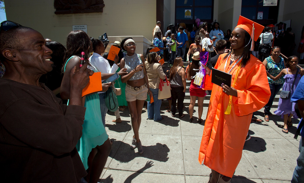 . Carmen Cummings, right, poses for a photograph with her freshly minted diploma following graduation ceremonies for the Class of 2013 at McClymonds High School, Thursday, June 13, 2013 in Oakland, Calif. (D. Ross Cameron/Bay Area News Group)