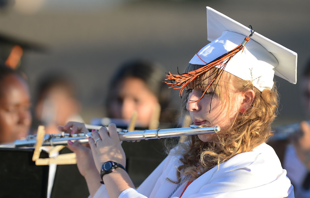 . Breezy conditions add to the evening as Sam Peters, a member of the Pittsburg High School Wind Ensemble and Concert Band, plays during the 2013 commencement ceremony at Pittsburg High School in Pittsburg, Calif., Wednesday,  June 12, 2013. (Susan Tripp Pollard/Bay Area News Group)
