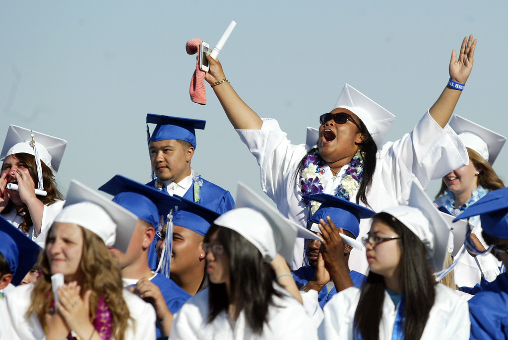 . Seniors of the Class of 2013 cheer to their classmates as they receive their diplomas during the graduation ceremony at Encinal High School in Alameda, Calif., on Friday, June 7, 2013.  (Ray Chavez / Bay Area News Group)