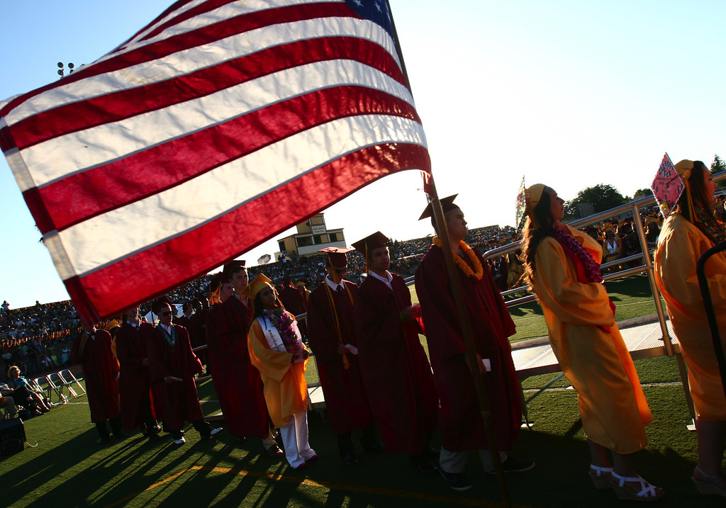 . Liberty High School Class of 2013 graduates line up to receive diplomas during their commencement ceremony on the school\'s Ohmstede Field in Brentwood, Calif., on Friday, June 7, 2013. (Anda Chu/Bay Area News Group)