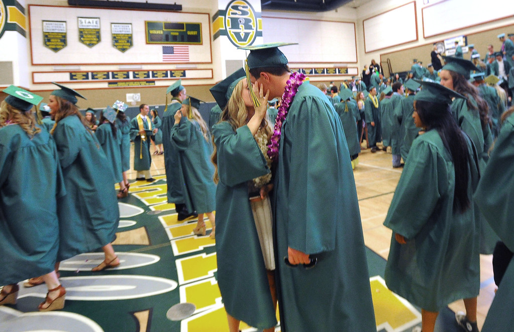 . San Ramon Valley High School graduates Melissa Vilas, left, and Connor Tetzloff, kiss before the start of the school\'s Commencement Ceremony in Danville, Calif., on Friday, June 14, 2013. (Doug Duran/Bay Area News Group)