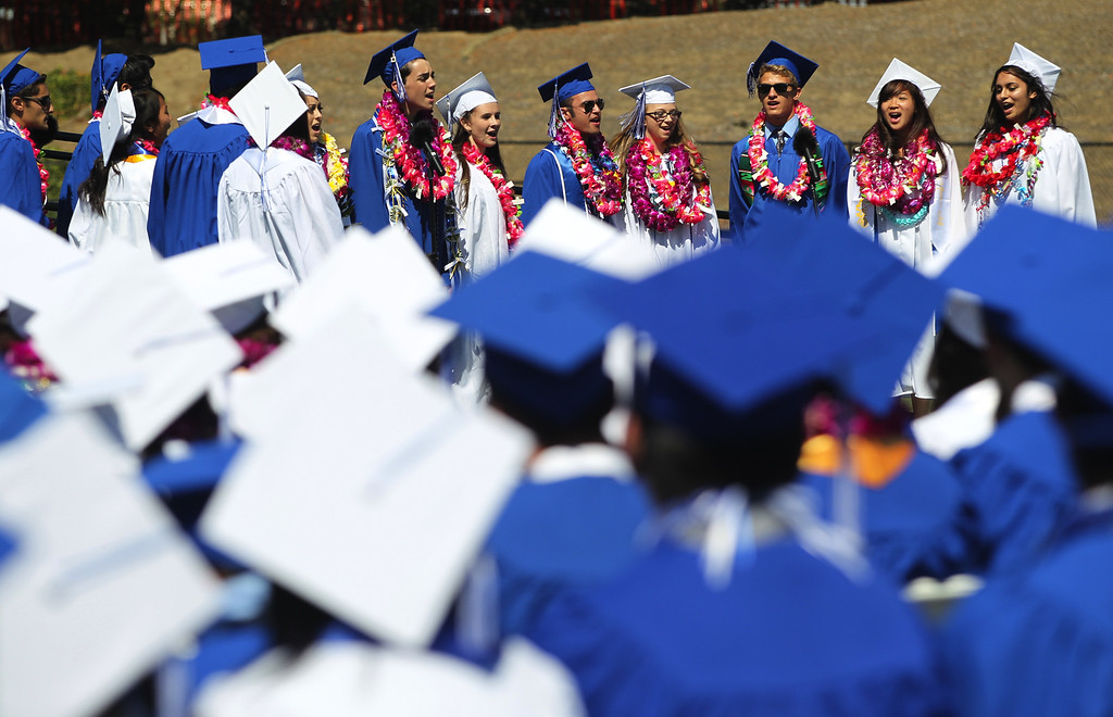 . Irvington High School graduates and members of the senior acapella group perform during their commencement ceremony in Fremont, Calif., on Thursday, June 20, 2013. (Anda Chu/Bay Area News Group)