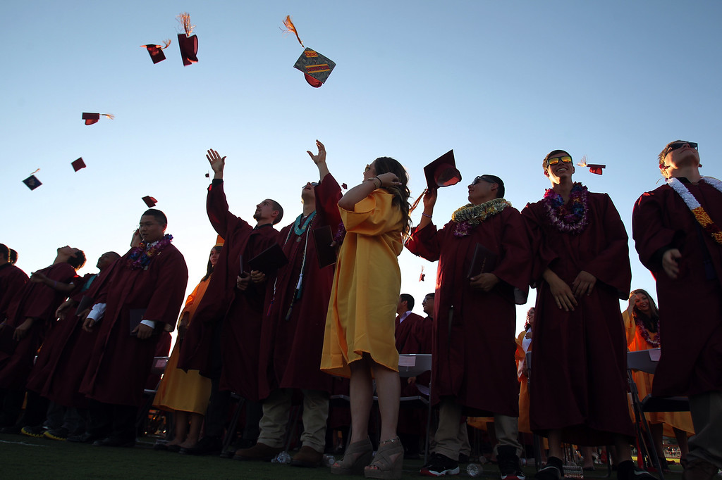 . Liberty High School Class of 2013 graduates celebrate during their commencement ceremony on the school\'s Ohmstede Field in Brentwood, Calif., on Friday, June 7, 2013. (Anda Chu/Bay Area News Group)