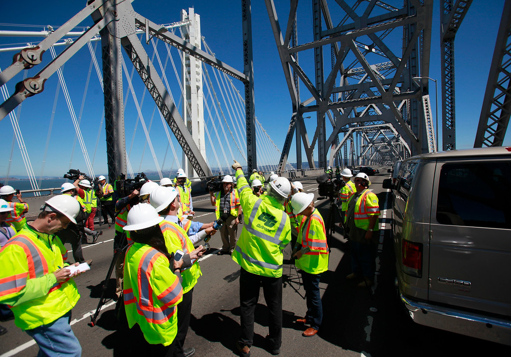 Description of . Caltrans senior engineer Brian Maroney points out features on the old cantilever section of the Bay Bridge while discussing with the media how the $239 million demolition project will proceed, Thursday, Aug. 29, 2013, in San Francisco, Calif.  (Karl Mondon/Bay Area News Group)