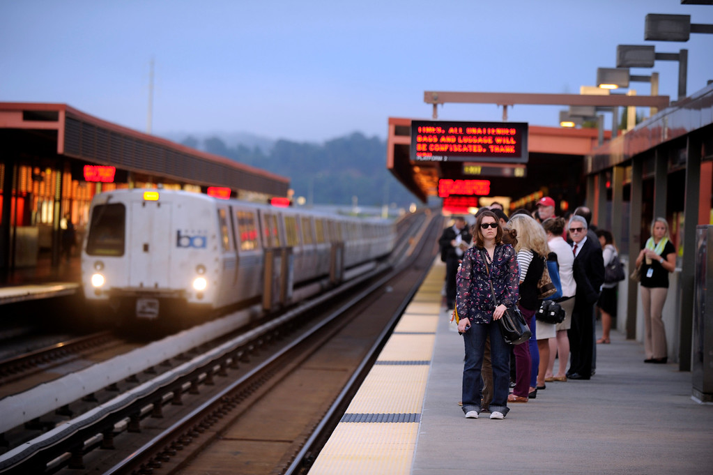 Description of . Commuters wait for a westbound train at 6:59 a.m. at the BART station in Walnut Creek on the first day of the Bay Bridge closure in Walnut Creek, Calif., on Thursday, Aug. 29, 2013. (Susan Tripp Pollard/Bay Area News Group)