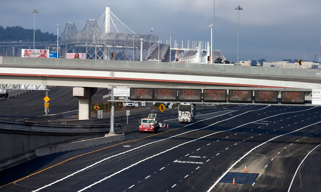 Description of . The newly repaved toll plaza sits ready for traffic to the new eastern span of the Bay Bridge, Sunday, Sept. 1, 2013, in Oakland, Calif., as work continued to prepare the new span for its scheduled opening on Tuesday at 5 a.m. (D. Ross Cameron/Bay Area News Group)