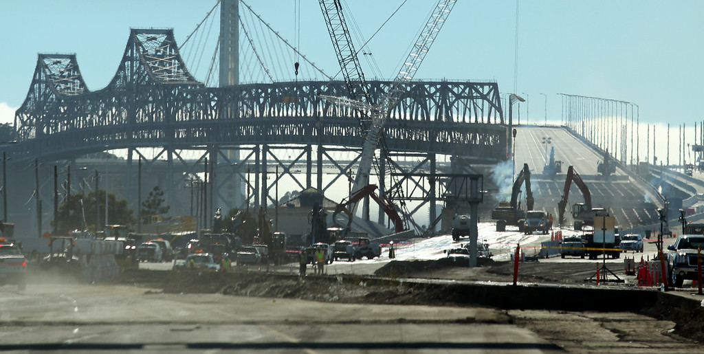 Description of . Demolition of the old eastern span of the Bay Bridge is underway near the toll plaza in Oakland, Calif., on Thursday, Aug. 30, 2013.  The new eastern span is scheduled to open on Tuesday, September 3, at 5 a.m. (Ray Chavez/Bay Area News Group)